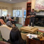 Travis Page speaking about hearing instruments at the dunlop house